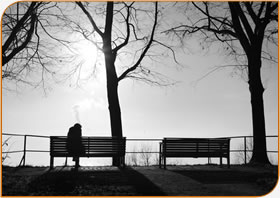 image of a person alone on a bench